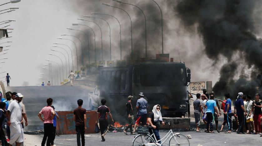 iraqi_protesters_burn_tires_and_block_the_road_at_the_entrance_to_the_city_of_basra._afp