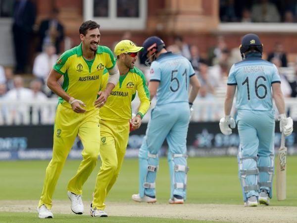 Australias-Mitchell-Starc-left-celebrates-taking-the-wicket-of-Englands-captain-AP