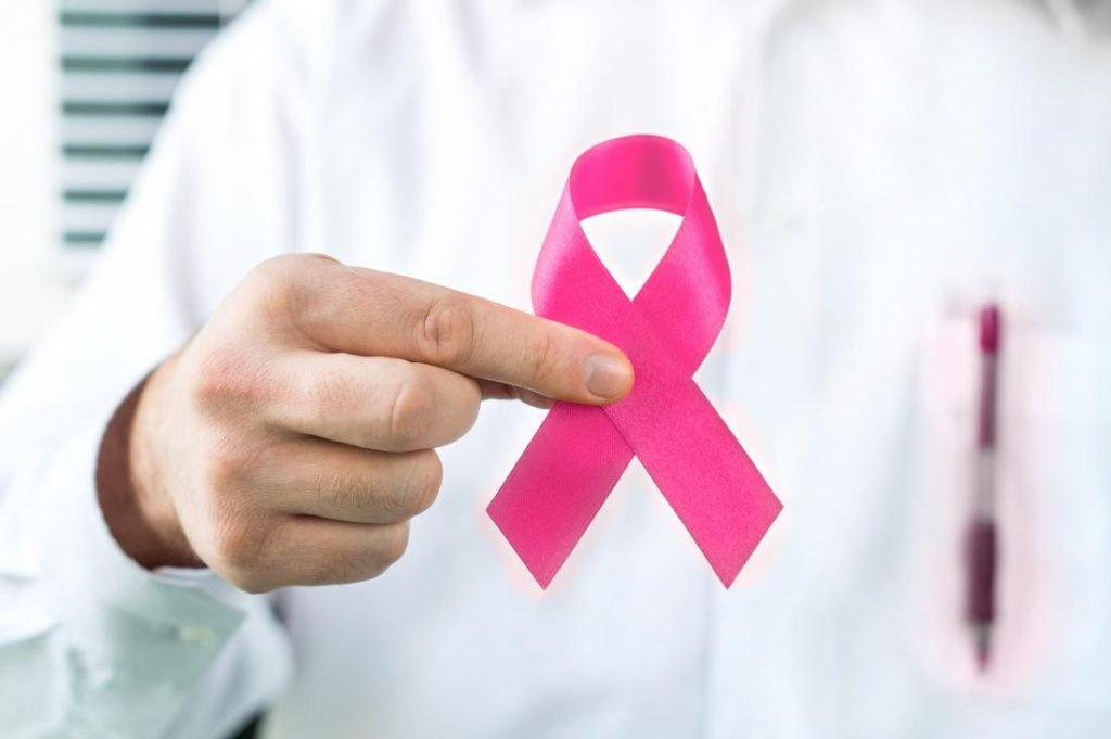 doctor-holding-breast-cancer-awareness-ribbon