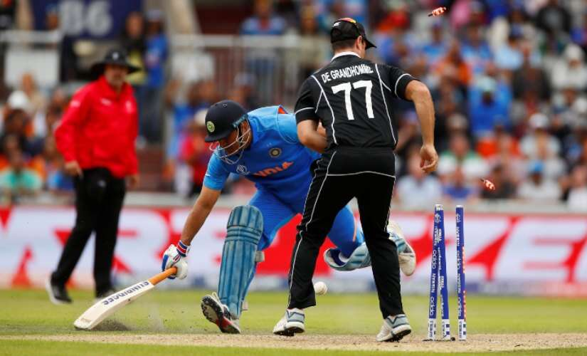 Martin-Guptill-dash-Indias-hopes-with-a-direct-hit-from-backward-square-to-catch-MS-Dhoni-inches-short-off-his-ground.-Reuters